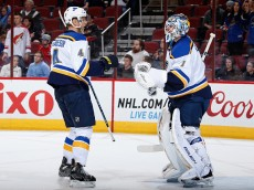 GLENDALE, AZ - JANUARY 06:  Carl Gunnarsson #4 of the St. Louis Blues congratulates goaltender Brian Elliott #1 after defeating the Arizona Coyotes 6-0 in the NHL game at Gila River Arena on January 6, 2015 in Glendale, Arizona.  (Photo by Christian Petersen/Getty Images)