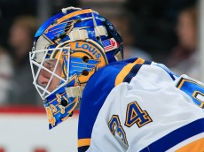 DENVER, CO - DECEMBER 13:  Goalie Jake Allen #34 of the St. Louis Blues looks on as he defends the goal against the Colorado Avalanche at Pepsi Center on December 13, 2014 in Denver, Colorado. The Blues defeated the Avalanche 3-2 in overtime. (Photo by Doug Pensinger/Getty Images)