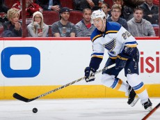 GLENDALE, AZ - JANUARY 06:  Kevin Shattenkirk #22 of the St. Louis Blues skates with the puck during the NHL game against the Arizona Coyotes at Gila River Arena on January 6, 2015 in Glendale, Arizona. The Blues defeated the Coyotes 6-0.  (Photo by Christian Petersen/Getty Images)