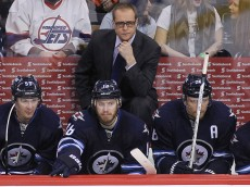 WINNIPEG, MB - FEBRUARY 16:  Head coach Paul Maurice of the Winnipeg Jets looks on from the bench in third-period action in an NHL game against the Edmonton Oilers at the MTS Centre on February 16, 2015 in Winnipeg, Manitoba, Canada. (Photo by Marianne Helm/Getty Images)