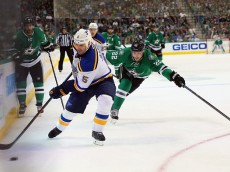 DALLAS, TX - MARCH 15:  Barret Jackman #5 of the St. Louis Blues skates the puck against Colton Sceviour #22 of the Dallas Stars in the first period at American Airlines Center on March 15, 2015 in Dallas, Texas.  (Photo by Ronald Martinez/Getty Images)