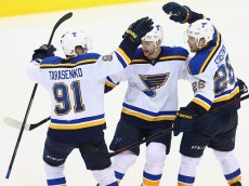 DALLAS, TX - MARCH 15:  (L-R) Vladimir Tarasenko #91, Alex Pietrangelo #27 and Paul Stastny #26 of the St. Louis Blues celebrate a goal against the Dallas Stars in the third period at American Airlines Center on March 15, 2015 in Dallas, Texas.  (Photo by Ronald Martinez/Getty Images)