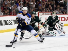 ST PAUL, MN - APRIL 20: Jaden Schwartz #17 of the St. Louis Blues controls the puck against Jared Spurgeon #46 and Devan Dubnyk #40 of the Minnesota Wild during the second period in Game Three of the Western Conference Quarterfinals during the 2015 NHL Stanley Cup Playoffs on April 20, 2015 at Xcel Energy Center in St Paul, Minnesota. (Photo by Hannah Foslien/Getty Images)