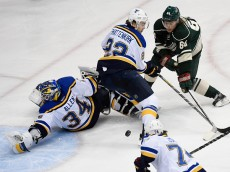 ST PAUL, MN - APRIL 20:  Goalie Jake Allen #34 of the St. Louis Blues blocks a shot by Mikael Granlund #64 of the Minnesota Wild as Kevin Shattenkirk #22 of the Blues helps to defend the net during the third period in Game Three of the Western Conference Quarterfinals during the 2015 NHL Stanley Cup Playoffs on April 20, 2015 at Xcel Energy Center in St Paul, Minnesota. The Wild defeated the Blues 3-0. (Photo by Hannah Foslien/Getty Images)
