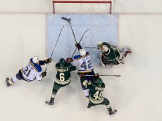 ST PAUL, MN - APRIL 22: David Backes #42 of the St. Louis Blues pushes the puck into the goal with help from teammate Patrik Berglund #21 against Marco Scandella #6, Jared Spurgeon #46 and goaltender Devan Dubnyk #40 of the Minnesota Wild during the first period in Game Four of the Western Conference Quarterfinals during the 2015 NHL Stanley Cup Playoffs on April 22, 2015 at Xcel Energy Center in St Paul, Minnesota. The Blues defeated the Wild 6-1. (Photo by Hannah Foslien/Getty Images)
