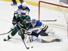 ST PAUL, MN - APRIL 26: Jake Allen #34 of the St. Louis Blues blocks a shot by Jason Zucker #16 of the Minnesota Wild as Jay Bouwmeester #19 of the St. Louis Blues helps defend the net during the first period in Game Six of the Western Conference Quarterfinals during the 2015 NHL Stanley Cup Playoffs on April 26, 2015 at Xcel Energy Center in St Paul, Minnesota. (Photo by Hannah Foslien/Getty Images)