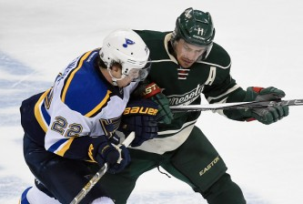 ST PAUL, MN - APRIL 26: Kevin Shattenkirk #22 of the St. Louis Blues and Zach Parise #11 of the Minnesota Wild skate after the puck during the third period in Game Six of the Western Conference Quarterfinals during the 2015 NHL Stanley Cup Playoffs on April 26, 2015 at Xcel Energy Center in St Paul, Minnesota. The Wild defeated the Blues 4-1 and took the series 4-2. (Photo by Hannah Foslien/Getty Images)