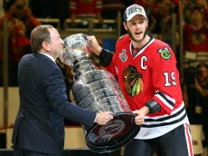 CHICAGO, IL - JUNE 15:  Jonathan Toews #19 of the Chicago Blackhawks is handed the Stanley Cup by National Hockey League Commissioner Gary Bettman after defeating the Tampa Bay Lightning  by a score of 2-0 in Game Six to win the 2015 NHL Stanley Cup Final at the United Center  on June 15, 2015 in Chicago, Illinois.  (Photo by Bruce Bennett/Getty Images)