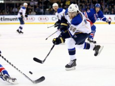 NEW YORK, NY - JANUARY 23:  Magnus Paajarvi #56 of the St. Louis Blues takes a shot in the first period against the New York Rangers at Madison Square Garden on January 23, 2014 in New York City.  (Photo by Elsa/Getty Images)