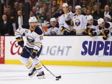 BOSTON, MA - MARCH 17:  Andre Benoit #61 of the Buffalo Sabres skates against the Boston Bruins during overtime  at TD Garden on March 17, 2015 in Boston, Massachusetts.  (Photo by Maddie Meyer/Getty Images)