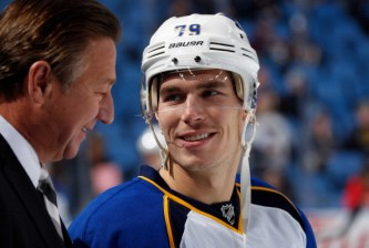 BUFFALO, NY - NOVEMBER 19: Adam Cracknell #79 of the St. Louis Blues talks to broadcaster Bernie Federko prior to playing the Buffalo Sabres at First Niagara Center on November 19, 2013 in Buffalo, New York.  (Photo by Jen Fuller/Getty Images)
