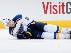 GLENDALE, AZ - JANUARY 06:  Patrik Berglund #21 of the St. Louis Blues falls to the ice during the NHL game against the Arizona Coyotes at Gila River Arena on January 6, 2015 in Glendale, Arizona. The Blues defeated the Coyotes 6-0.  (Photo by Christian Petersen/Getty Images)