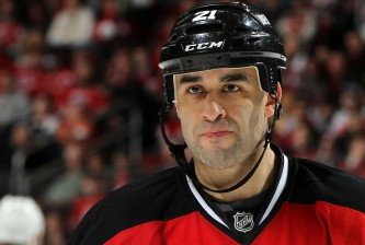NEWARK, NJ - MARCH 29:  Scott Gomez #21 of the New Jersey Devils looks on during the third period against the Anaheim Ducks at the Prudential Center on March 29, 2015 in Newark, New Jersey. The Ducks defeated the Devils 2-1. (Photo by Christopher Pasatieri/Getty Images)