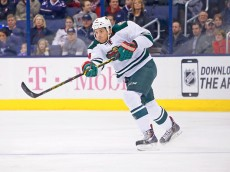 COLUMBUS, OH - DECEMBER 31:  Stu Bickel #4 of the Minnesota Wild controls the puck during the game against the Columbus Blue Jackets on December 31, 2014 at Nationwide Arena in Columbus, Ohio. (Photo by Kirk Irwin/Getty Images)