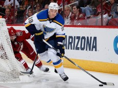GLENDALE, AZ - JANUARY 06:  Jay Bouwmeester #19 of the St. Louis Blues skates with the puck ahead of Sam Gagner #9 of the Arizona Coyotes during the first period of the NHL game at Gila River Arena on January 6, 2015 in Glendale, Arizona.  (Photo by Christian Petersen/Getty Images)