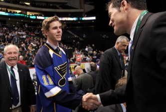 ST PAUL, MN - JUNE 25:  46th overall pick Joel Edmundson by the St. Louis Blues is greeted by a member of the St. Louis Blues on the draft floor during day two of the 2011 NHL Entry Draft at Xcel Energy Center on June 25, 2011 in St Paul, Minnesota.  (Photo by Bruce Bennett/Getty Images)