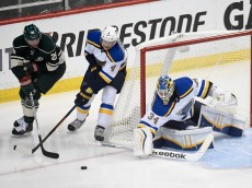 ST PAUL, MN - APRIL 20:  Thomas Vanek #26 of the Minnesota Wild brings the puck around the net against Carl Gunnarsson #4 and Jake Allen #34 of the St. Louis Blues during the first period in Game Three of the Western Conference Quarterfinals during the 2015 NHL Stanley Cup Playoffs on April 20, 2015 at Xcel Energy Center in St Paul, Minnesota. (Photo by Hannah Foslien/Getty Images)