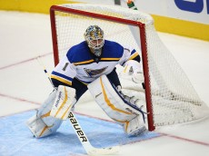 DALLAS, TX - SEPTEMBER 29:  Brian Elliott #1 of the St. Louis Blues in the net against the Dallas Stars during a preseason game at American Airlines Center on September 29, 2015 in Dallas, Texas.  (Photo by Ronald Martinez/Getty Images)