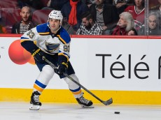 MONTREAL, QC - OCTOBER 20:  Scott Gomez #93 of the St. Louis Blues skates with the puck during the NHL game against the Montreal Canadiens at the Bell Centre on October 20, 2015 in Montreal, Quebec, Canada.  The Montreal Canadiens defeated the St. Louis Blues 3-0.  (Photo by Minas Panagiotakis/Getty Images)