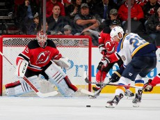 NEWARK, NJ - NOVEMBER 10:  Cory Schneider #35 of the New Jersey Devils defends his net as Martin Havlat #29 of the St. Louis Blues lines up his shot in the second period on November 10, 2015 at the Prudential Center in Newark, New Jersey.  (Photo by Elsa/Getty Images)