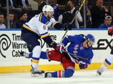 NEW YORK, NY - NOVEMBER 12: Kevin Hayes #13 of the New York Rangers is checked by Joel Edmundson #6 of the St. Louis Blues during the second period at Madison Square Garden on November 12, 2015 in New York City.  (Photo by Bruce Bennett/Getty Images)