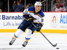 NEWARK, NJ - NOVEMBER 10:  Scott Gomez #93 of the St. Louis Blues takes the puck in the third period against the New Jersey Devils on November 10, 2015 at the Prudential Center in Newark, New Jersey.The St. Louis Blues defeated the New Jersey Devils 2-0.  (Photo by Elsa/Getty Images)