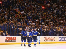 ST. LOUIS, MO - OCTOBER 8: Troy Brouwer #36 of the St. Louis Blues is congratulated by teammates after scoring his first goal as a member of the Blues against the Edmonton Oilers  at the Scottrade Center on October 8, 2015 in St. Louis, Missouri.  (Photo by Dilip Vishwanat/Getty Images)