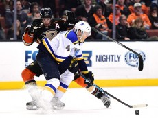 ANAHEIM, CA - JANUARY 08:  Ryan Kesler #17 of the Anaheim Ducks attempts a move around Carl Gunnarsson #4 of the St. Louis Blues during the third period at Honda Center on January 8, 2016 in Anaheim, California.  (Photo by Harry How/Getty Images)