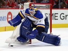 CHICAGO, IL - JANUARY 24: Brian Elliott #1 of the St. Louis Blues scoops up the puck against the Chicago Blackhawks at the United Center on January 24, 2016 in Chicago, Illinois. The Blackhawks defeated the Blues 2-0. (Photo by Jonathan Daniel/Getty Images)