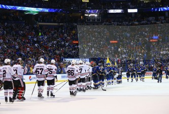 ST. LOUIS, MO - APRIL 25: Members of the Chicago Blackhawks and the St. Louis Blues line up for the post-series handshakes after Game Seven of the Western Conference First Round during the 2016 NHL Stanley Cup Playoffs at the Scottrade Center on April 25, 2016 in St. Louis, Missouri.  The blues beat the Blackhawks 3-2 to win the series.  (Photo by Dilip Vishwanat/ Getty Images)