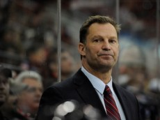 RALEIGH, NC - MARCH 16:  Coach Kirk Muller of the Carolina Hurricanes watches his team during a 2-1 loss to the Edmonton Oilers at PNC Arena on March 16, 2014 in Raleigh, North Carolina.  (Photo by Grant Halverson/Getty Images)