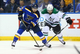 ST. LOUIS, MO - MAY 3: Robby Fabbri #15 takes control of the puck from Jason Demers #4 of the Dallas Stars in Game Three of the Western Conference Second Round during the 2016 NHL Stanley Cup Playoffs at the Scottrade Center on May 3, 2016 in St. Louis, Missouri.  (Photo by Dilip Vishwanat/Getty Images)