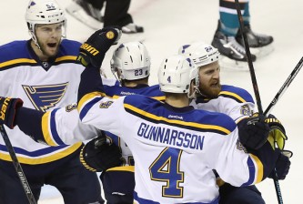SAN JOSE, CA - MAY 21:  Kyle Brodziak #28 of the St. Louis Blues celebrates with teammates after his second goal in game four of the Western Conference Finals against the San Jose Sharks during the 2016 NHL Stanley Cup Playoffs at SAP Center on May 21, 2016 in San Jose, California.  (Photo by Sean M. Haffey/Getty Images)