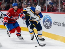 MONTREAL, QC - OCTOBER 20:  Jaden Schwartz #17 of the St. Louis Blues skates with the puck against David Desharnais #51 of the Montreal Canadiens during the NHL game at the Bell Centre on October 20, 2015 in Montreal, Quebec, Canada. (Photo by Minas Panagiotakis/Getty Images)