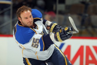 DENVER - NOVEMBER 15:  Cam Janssen #55 of the St. Louis Blues warms up prior to facing the Colorado Avalanche at the Pepsi Center on November 15, 2010 in Denver, Colorado. The Avalacnhe defeated the Blues 6-3.  (Photo by Doug Pensinger/Getty Images)