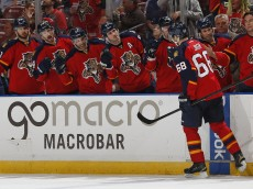 SUNRISE, FL - MARCH 19: Jaromir Jagr #68 of the Florida Panthers is congratulated by teammates after scoring the first goal of the game against the Detroit Red Wings during second period action at the BB&T Center on March 19, 2015 in Sunrise, Florida. (Photo by Joel Auerbach/Getty Images)