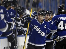 TAMPA, FL - JANUARY 18:  Martin St. Louis #26 of the Tampa Bay Lightning celebrates a goal against the San Jose Sharks at the Tampa Bay Times Forum on January 18, 2014 in Tampa, Florida. (Photo by Mike Carlson/Getty Images)
