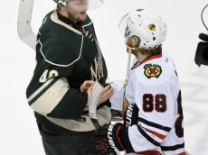 ST PAUL, MN - MAY 7: Devan Dubnyk #40 of the Minnesota Wild shakes hands with Patrick Kane #88 of the Chicago Blackhawks after Game Four of the Western Conference Semifinals during the 2015 NHL Stanley Cup Playoffs on May 7, 2015 at Xcel Energy Center in St Paul, Minnesota. The Blackhawks defeated the Wild 4-3 to sweep the series. (Photo by Hannah Foslien/Getty Images)
