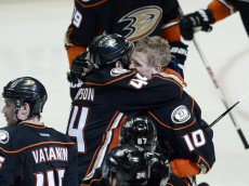 ANAHEIM, CA - MAY 10: Corey Perry #10 of the Anaheim Ducks, who scored the game winning goal in overtime, gets congratulated by teammate Nate Thompson #44 against Calgary Flames in Game Five of the Western Conference Semifinals during the 2015 Stanley Cup Playoffs at Honda Center on May 10, 2015 in Anaheim, California. Ducks eliminated the Flames, 3-2, in overtime. (Photo by Kevork Djansezian/Getty Images)