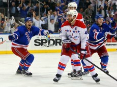NEW YORK, NY - MAY 13:  Jesper Fast #19 and Chris Kreider #20 of the New York Rangers celebrate after the game winning goal of Derek Stepan #21 in overtime against the Washington Capitals to win Game Seven of the Eastern Conference Semifinals by a score of 2-1 during the 2015 NHL Stanley Cup Playoffs at Madison Square Garden on May 13, 2015 in New York City.  (Photo by Bruce Bennett/Getty Images)