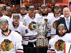 ANAHEIM, CA - MAY 30:  The Chicago Blackhawks pose in front of the Clarence S. Campbell Bowl with NHL Deputy Commissioner Bill Daly after the Blackhawks 5-3 victory against the Anaheim Ducks in Game Seven of the Western Conference Finals during the 2015 NHL Stanley Cup Playoffs  at the Honda Center on May 30, 2015 in Anaheim, California.  (Photo by Harry How/Getty Images)