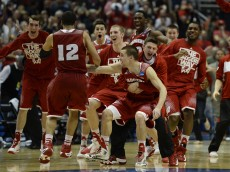 Mar 29, 2014; Anaheim, CA, USA; Wisconsin Badgers players celebrate after overtime in the finals of the west regional of the 2014 NCAA Mens Basketball Championship tournament against the Arizona Wildcats at Honda Center. The Badgers defeated the Wildcats 64-63. Mandatory Credit: Richard Mackson-USA TODAY Sports