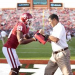 NORMAN, OK - SEPTEMBER 22:  Co-offensive coordinator Jay Norvell and wide receiver Justin Brown #19 of the Oklahoma Sooners warm up before the game against the Kansas State Wildcats  on September 22, 2012 at Gaylord Family-Oklahoma Memorial Stadium in Norman, Oklahoma. Kansas State beat Oklahoma 24-19. (Photo by Brett Deering/Getty Images)