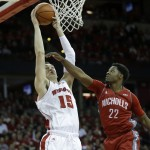 MADISON, WI - DECEMBER 13: Sam Dekker #15 of the Wisconsin Badgers drives to the hoop during the first half against the Nicholls State Colonels at Kohl Center on December 13, 2014 in Madison, Wisconsin. (Photo by Mike McGinnis/Getty Images)