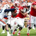 TAMPA, FL - JANUARY 1:   Running back Melvin Gordon #25 of the Wisconsin Badgers fends off a tackle by defensive back Johnathan Ford #23 of the Auburn Tigers  of the Auburn Tigers during the first quarter of the Outback Bowl on January 1, 2015 at Raymond James Stadium in Tampa, Florida.  (Photo by Brian Blanco/Getty Images) *** Local Caption *** Melvin Gordon; Johnathan Ford