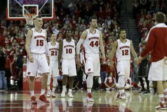 MADISON, WI - JANUARY 07: Frank Kaminsky #44 of the Wisconsin Badgers along with Sam Dekker #15, Traevon Jackson #12, Nigel Hayes #10, and Josh Gasser #21 of the Purdue Boilermakers during the second half against Wisconsin Badgers at Kohl Center on January 07, 2015 in Madison, Wisconsin. (Photo by Mike McGinnis/Getty Images)