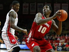 PISCATAWAY, NJ - JANUARY 11: Nigel Hayes #10 of the Wisconsin Badgers looks to take a shot as Greg Lewis #35 of the Rutgers Scarlet Knights defends during the first half of a college basketball game at the Rutgers Athletic Center on January 11, 2015 in Piscataway, NJ. (Photo by Rich Schultz /Getty Images)