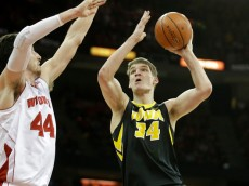 MADISON, WI - JANUARY 20: Adam Woodbury #34 of the Iowa Hawkeyes shoots a jumper during the first half against Wisconsin Badgers at Kohl Center on January 20, 2015 in Madison, Wisconsin. (Photo by Mike McGinnis/Getty Images)  *** Local Caption *** Adam Woodbury