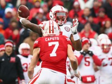 MADISON, WI - NOVEMBER 15:  Tommy Armstrong Jr. #4 of the Nebraska Cornhuskers throws the ball against Michael Caputo #7 of the Wisconsin Badgers at Camp Randall Stadium on November 15, 2014 in Madison, Wisconsin.  (Photo by Ronald Martinez/Getty Images)