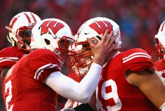 MADISON, WI - NOVEMBER 15:  (L-R) Joel Stave #2 of the Wisconsin Badgers and Sam Arneson #49 celebrate a touchdown against the Nebraska Cornhuskers at Camp Randall Stadium on November 15, 2014 in Madison, Wisconsin.  (Photo by Ronald Martinez/Getty Images)